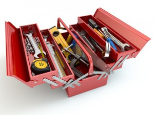 Toolbox with tools on white isolated background.